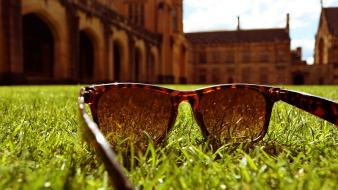 Blurred background buildings grass low-angle shot sunglasses Wallpaper