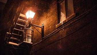 Brick wall lanterns snow stairways urban Wallpaper