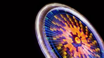 Black background ferris wheels lights long exposure multicolor wallpaper