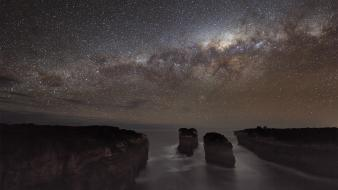 Milky way cliffs coast galaxies long exposure wallpaper