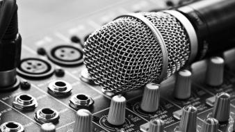 Close-up grayscale microphones music studio wallpaper