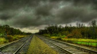 Clouds landscapes nature railroad tracks trees Wallpaper