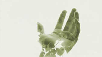 Double exposure green hands leaves minimalistic wallpaper