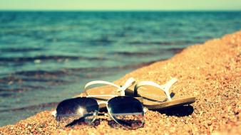 Glasses sand sea wallpaper