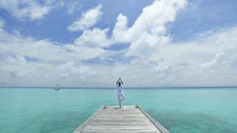 Maldives blue water yoga wallpaper