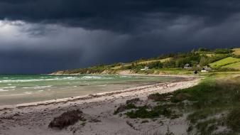 Beaches dark clouds grass hills houses wallpaper