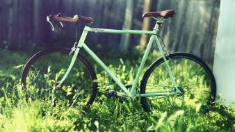 Bicycles blurred background grass wallpaper