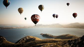 Hot air balloons mountains sea Wallpaper