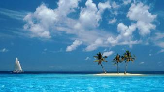 Clouds islands palm trees sea yachts wallpaper